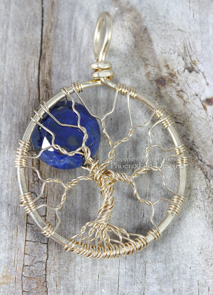 "Custom tree of life pendant in SOLID 14k gold wire and featuring a faceted natural blue sapphire round coin bead ""moon"" within the branches. This was made to celebrate a new baby girl born in September. Sapphire is the birthstone for September."