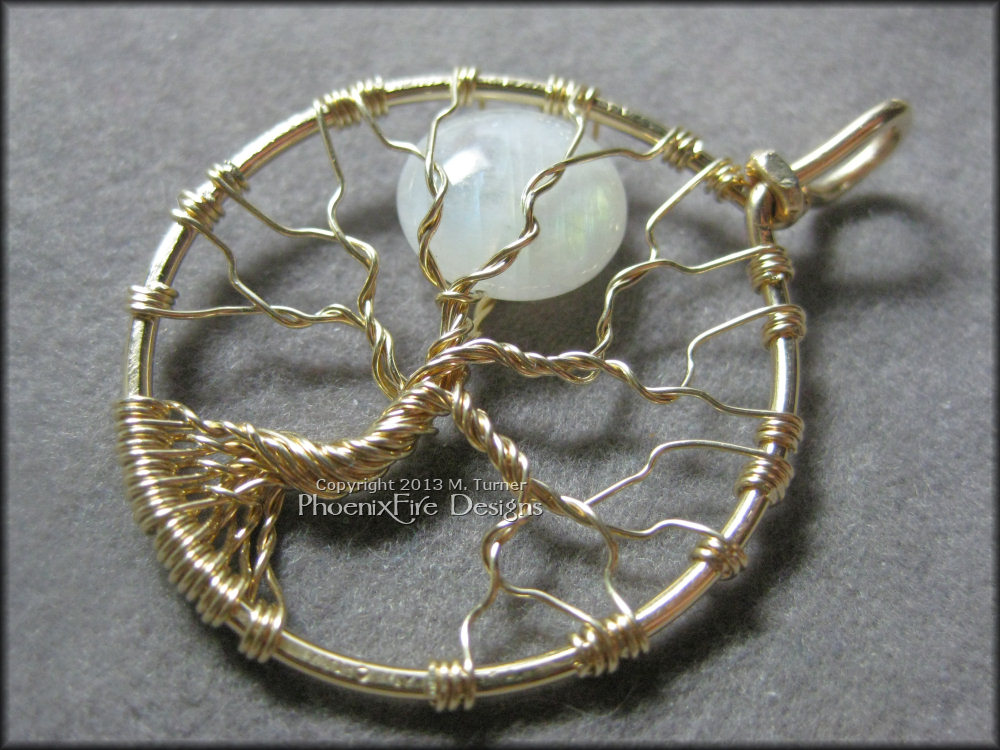 10mm Natural Rainbow Moonstone set in 14k gold fill wire.