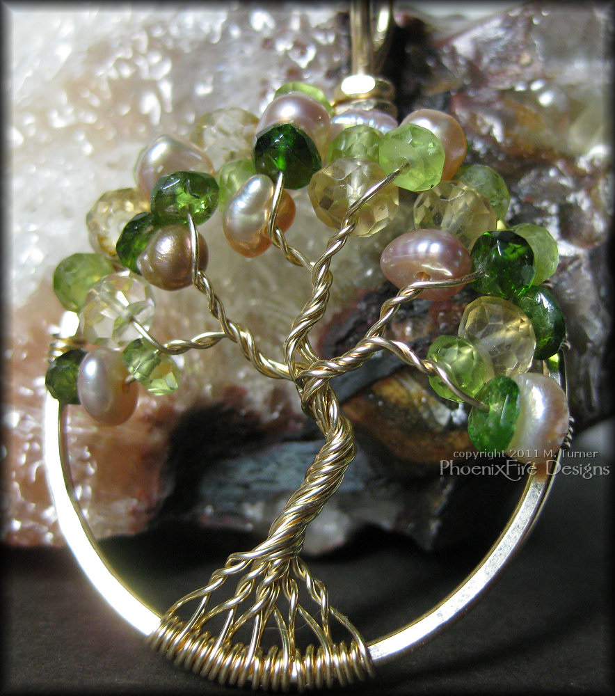This piece is a custom birthstone piece in 14k gold fill wire and featuring Chrome Diopside for May (Emerald), Peridot for August, Citrine for November and Freshwater Pearl for June.