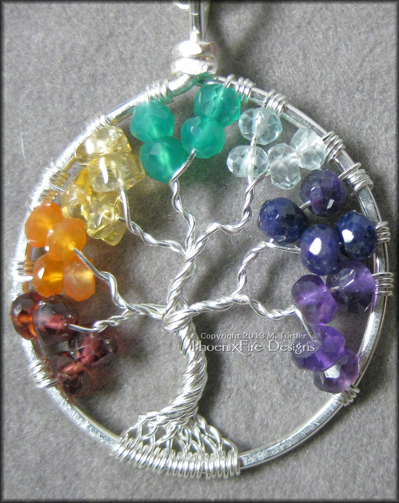 For this, my customer wanted to get a special tree for his wife who is a Yoga instructor. Using the seven colors of the Chakra, I made this tree to celebrate her passion. With Garnet, Carnelian, Citrine, Green Aventurine, Blue Topaz, Blue Sapphire and Amethyst.