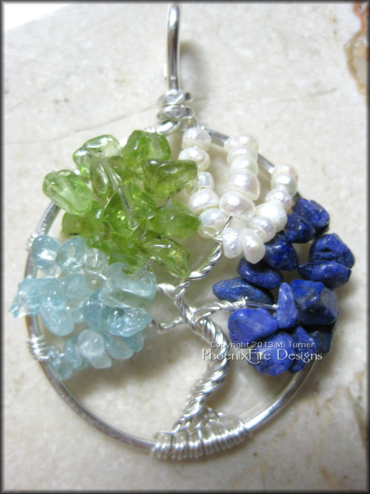 This is another family tree with birthstones. Aquamarine for March, Peridot for August, Pearl for June and Blue Lapis Lazuli for September's Blue Sapphire.