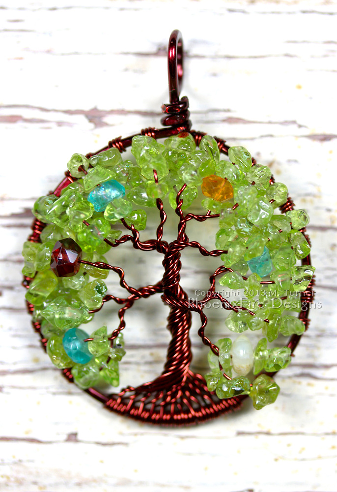 "Extremely lush custom ""Oak Tree"" with two dozen branches in brown wire, peridot leaves and scattered birthstones (December blue zircon, January Garnet, November Citrine, October Opal) in the branches."