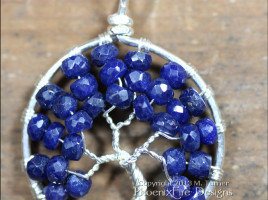 Stunning blue sapphire micro-faceted rondelles are set in sterling silver wire to form a beautiful Tree of Life pendant. Precious sapphire is the birthstone of September.