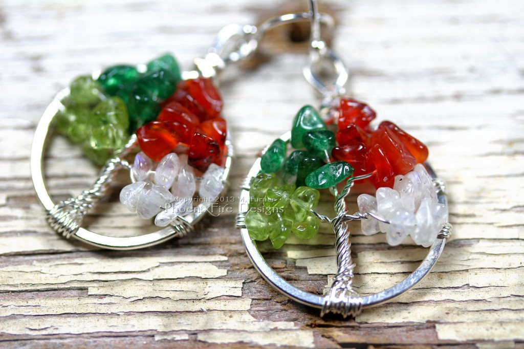 Miniature Four Season Tree of Life pendant earrings features peridot, green aventurine, red carnelian and rainbow moonstone and hang on .925 sterling silver ear wire hooks.