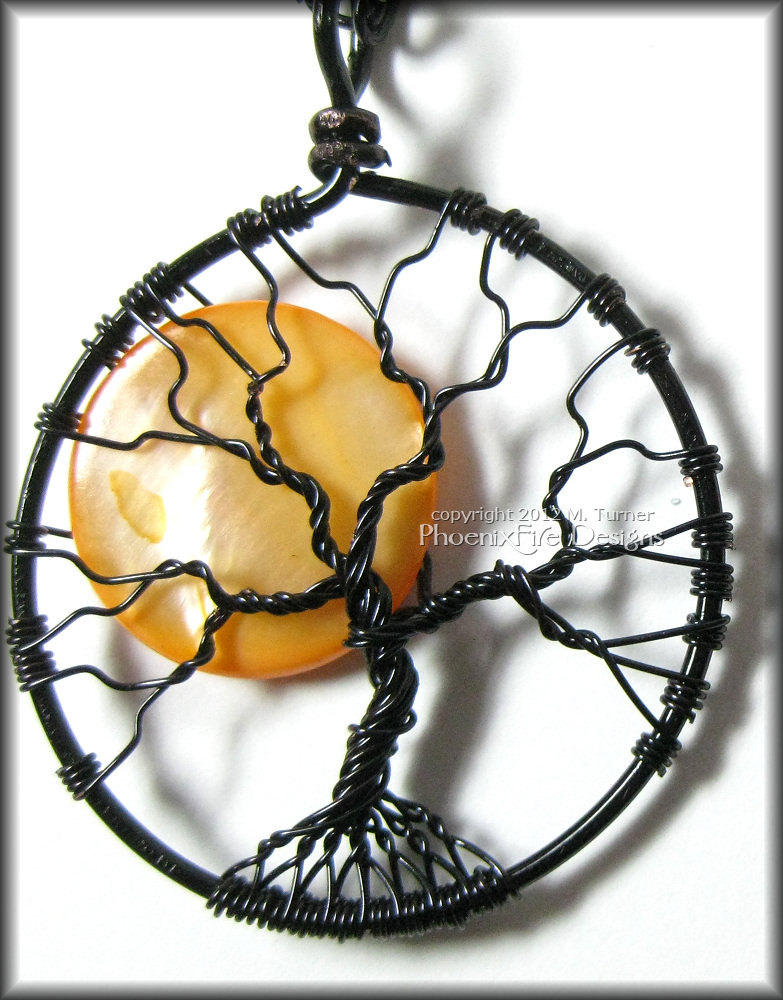 Halloween inspired Spooky Tree with bare black branches and a full moon, harvest moon in the night sky.
