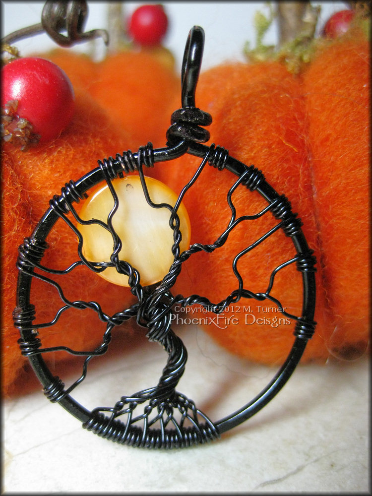 This is a smaller version of my normal Spooky Tree of Life Pendant. Bare branches in black wire under a full, orange moon.  by PhoenixFire Designs