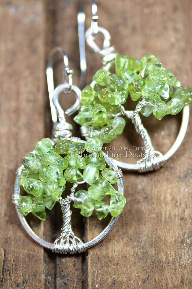 This pair of dainty Tree of Life earrings features genuine, natural Peridot gemstones and hangs on .925 sterling silver French ear wire hooks. Artisan original jewelry handmade by Miss M. Turner of PhoenixFire Designs