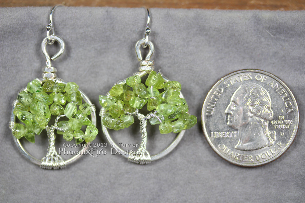 This pair of dainty Tree of Life earrings features genuine, natural Peridot gemstones and hangs on .925 sterling silver French ear wire hooks. Handmade wire wrapped original artisan jewelry by Miss M. Turner of PhoenixFIre Designs