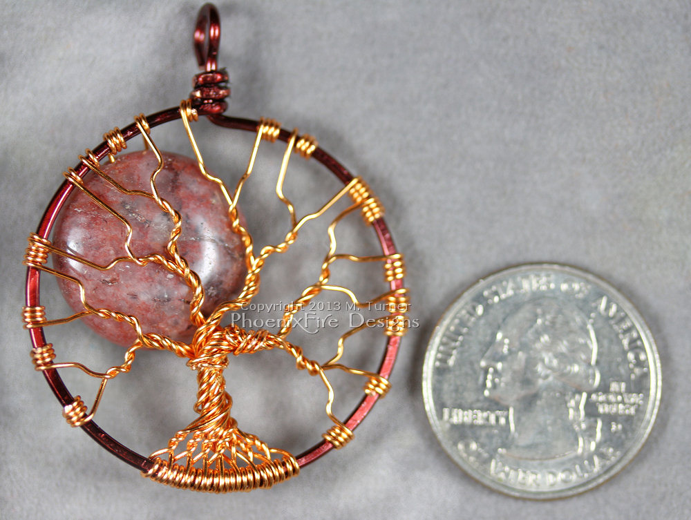 This Red Lodolite Autumn Harvest Full Moon Tree of Life pendant is wrapped in two tone brown and copper wire. Also known as Garden Quartz, Lodalite, Lodelite, and Inclusion Quartz as well.