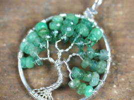 Stunning shaded ombre emerald rondelles in silver wire make up this handcrafted, wire wrapped Tree of Life Pendant featuring May's precious gemstone birthstone.