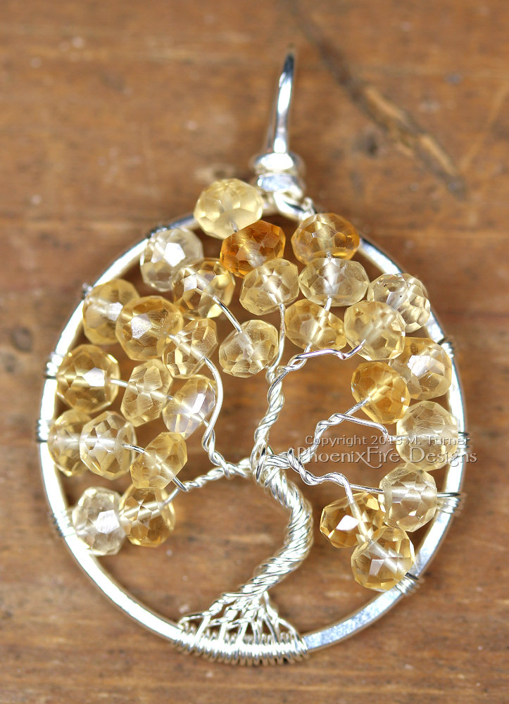 Soft, pale shaded yellow faceted citrine rondelle gemstones are the centerpiece of this Tree of Life pendant handmade wire wrapped in silver wire. Birthstone of November.