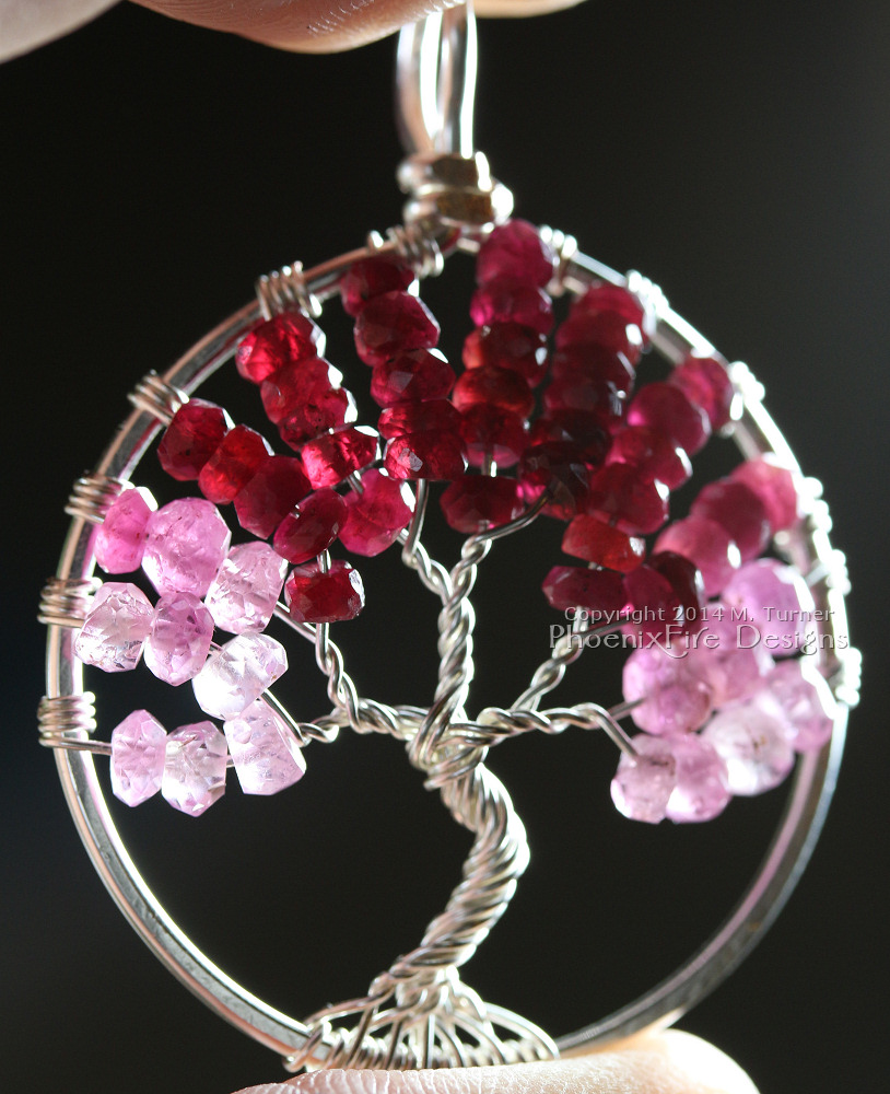 Tree of Life pendant in stunning shaded ombre red, raspberry and pink ruby rondelles wire wrapped in silver wire feature July's precious gemstone birthstone by PhoenixFire Designs.