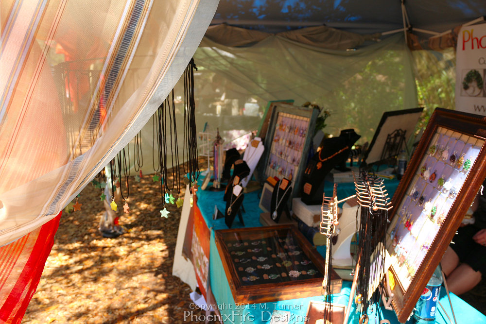 PhoenixFire Designs  by Miss M. Turner tent and wares on display as a vendor at the Bay Area Renaissance Festival in Tampa, Florida