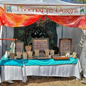 Handcrafted gemstone jewelry and wire wrapped tree of life pendants by PhoenixFire Designs craft show booth display at the Bay Area Renaissance Festival March 2015