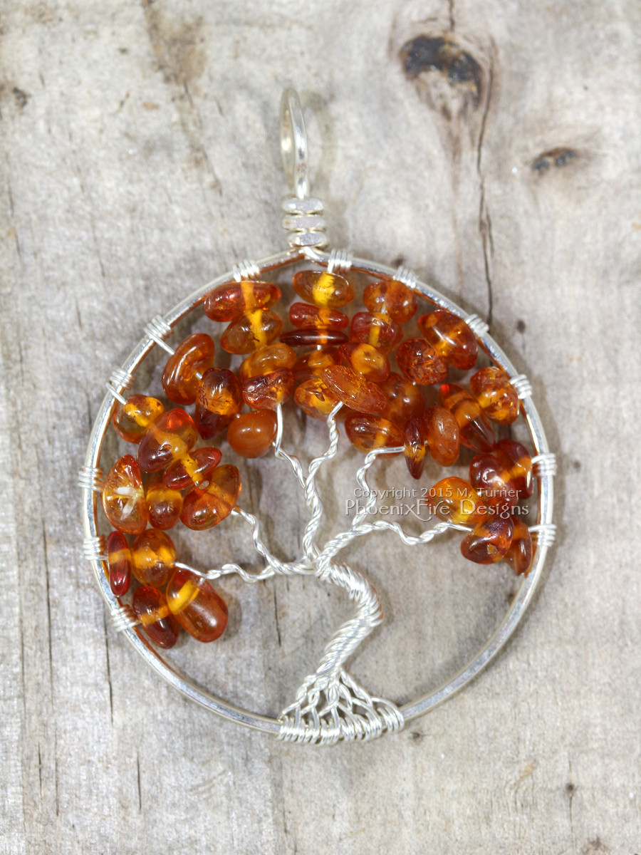 Handmade wire wrapped tree of life pendant baltic amber autumn leaves handcrafted by maker miss m. turner of Phoenix Fire Designs on etsy.
