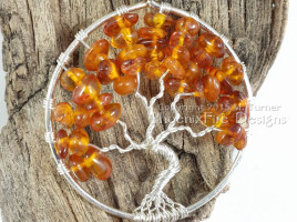 Handmade wire wrapped tree of life pendant in Baltic Amber autumn leaves silver wire wrap tree by Phoenix Fire Designs on etsy.