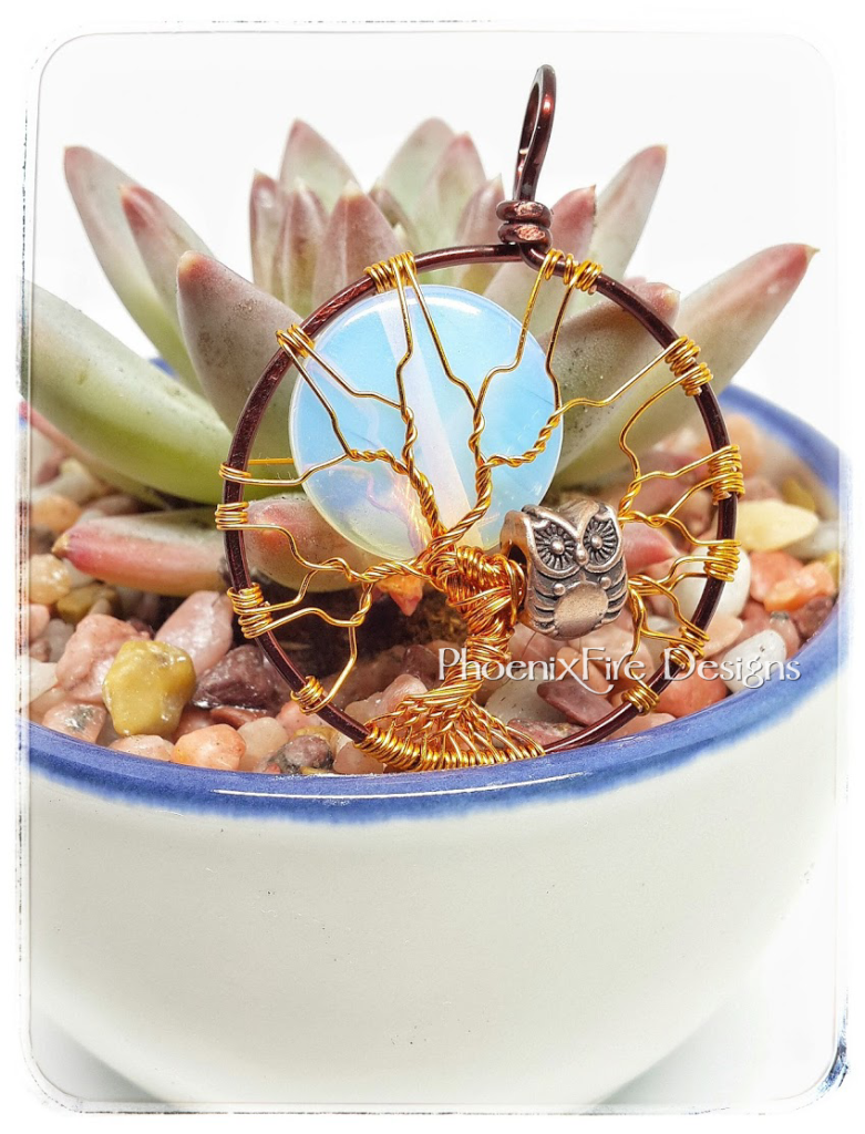 Opalite rainbow moonstone full moon tree of life, two tone mixed metal steampunk style brown and copper wire wrapped jewelry, with copper wire owl bead charm in the bare wire branches of this handmade artisan maker tree of life pendant by PhoenixFire Designs on etsy. Miniature succulent planted in china tea cup.