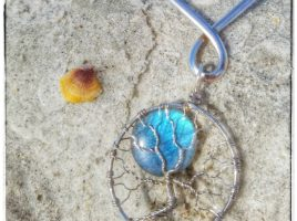 Handmade, blue flash labradorite full moon wire wrapped tree of life pendant by PhoenixFire Designs fits in nicely with the beaches of Clearwater St. Petersburg, Florida. Order yours from the PhoenixFire Designs etsy shop.