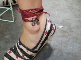 Another PhoenixFire Designs happy customer at Tampa Indie Flea who immediately put on her vintage recycled sari silk wrap bracelet as an anklet!