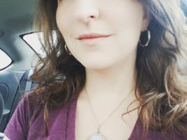 Artisan jewelry maker, M. Turner of PhoenixFire Designs about town wearing one of her famous creations: full moon opalite moonstone tree of life pendant celestial necklace.