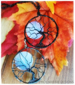 Best selling PhoenixFire Designs famous opalite moonstone full moon tree of life pendants handmade in black wire or gunmetal wire wrapped necklace.