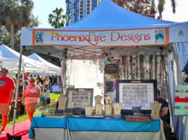 PhoenixFire Designs handmade, wire wrapped jewelry tree of life pendant necklaces, celestial jewelry and more vendor booth at Shopapalooza Festival south straub park downtown st petersburg. Shop small, shop local!