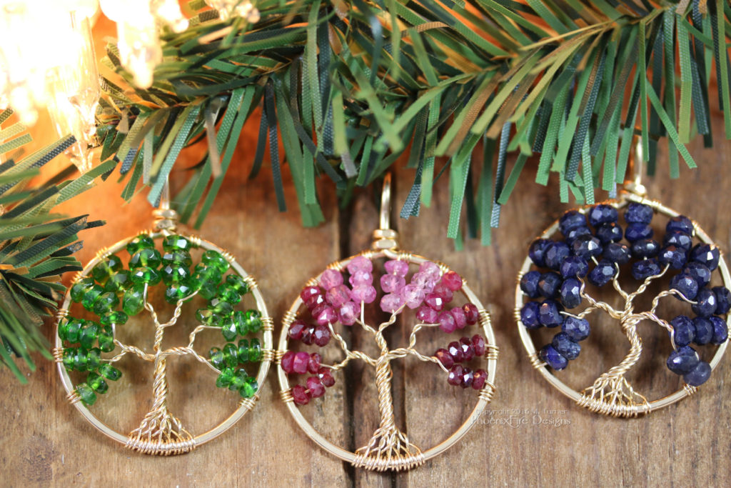 Three 14k gf Tree of Life Pendants handmade by PhoenixFire Designs featuring emerald green Chrome Diopside, an Ombre of shaded Ruby, and deep Blue Sapphire.