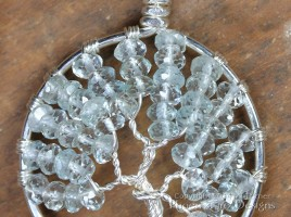 Tree of Life Pendant in striking pale blue faceted aquamarine rondelles wire wrapped in non-tarnish silver wire forming a handmade pendant in the icy birthstone of March. Handmade by Miss M Turner of PhoenixFire Deisgns on etsy.