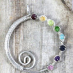 Handmade wire wrapped rainbow spiral eternity circle pendant by PhoenixFire Designs on etsy.