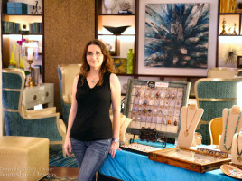 Jewelry Artist Miss M. Turner of PhoenixFire Designs stands in front of the local artisan showcase at the Vinoy Resort, St. Petersburg July 24, 2015