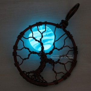 Glowing blue moon glow in the dark tree of life pendant, wire wrapped in your choice of wire by PhoenixFire Designs. This glow in the dark necklace truly glows and is also UV and blacklight reactive.